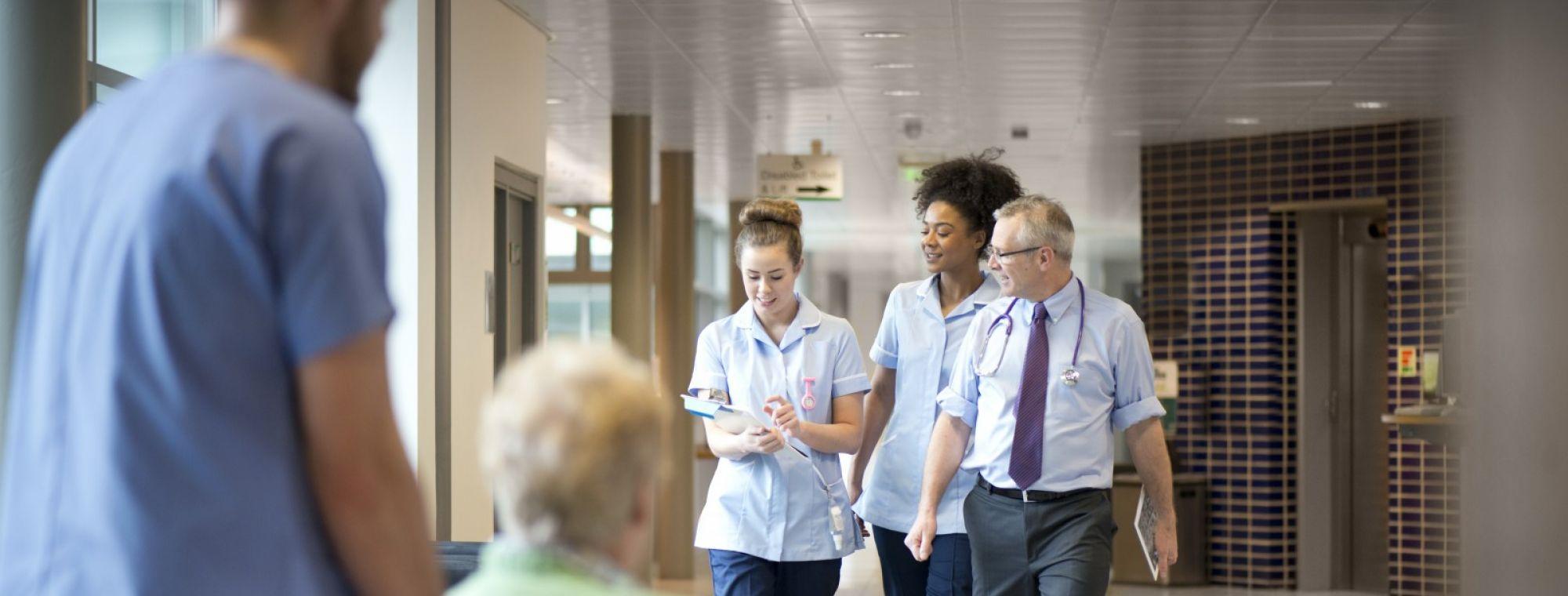 medical team walking in hallway